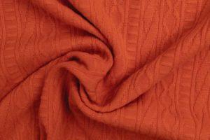 Jacquard gebreide stof, kabel relief, roest oranje